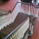 stained-hand rail with paint grade picketts-hardwood floors