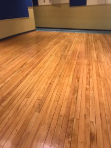 refinish-wood-floor-gym-theater